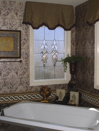 Picture windows are an exquisite setting for leaded glass. Here, the use of vine glass adds privacy without losing any available natural light