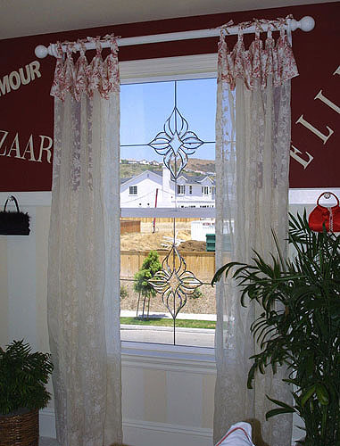Look what adding a simple floral design to the windows can do, while maintaining the view