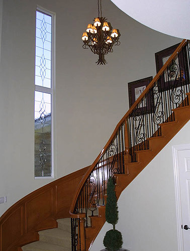 Notice how our leaded glass compliment this elegant stairwell and chandelier setting